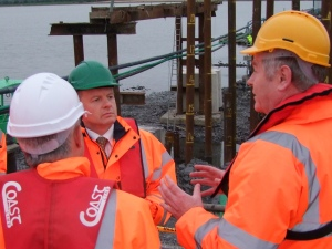 Minister Sargent is briefed by Barry Kenny and Eammon Ballance, Chief Civil Engineer, Iaranroid Eireann